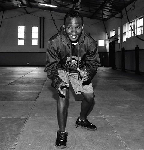 Tanki Tau hired as first black TuksWrestling coach